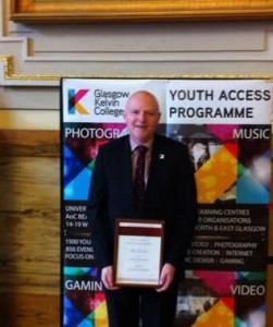 Alan Sherry, Principal at Glasgow Kelvin College with the Beacon Award presented for the College's innovative Youth Access Programme which was judged to be a shining example of this type of programme in the 'Widening Participation 14-19yrs'