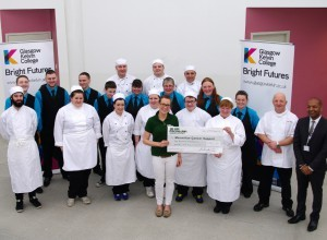 Some of the Glasgow Kelvin students and staff presenting the cheque to Eloise Armstrong, Fundraising Manager for Macmillan Cancer Support