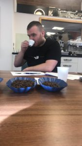 student sampling coffee