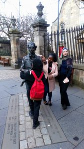 ESOL Students beside statue