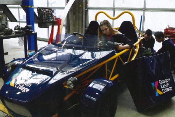 student with kit car