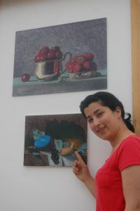 student with paintings