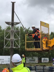 workmen on digger lift