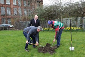 Orchard Project - Volunteers digging a hole