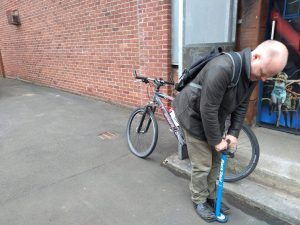 Dr Bike session at West End campus - inflating tyres