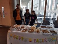 Students selling cakes for BlankFaces