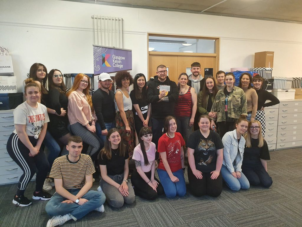 Fashion staff and students presenting a cheque to Blankfaces