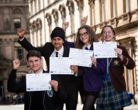 Four Foundation Apprentices with their certificates
