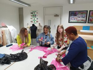 Fashion student designing garments using bin bags