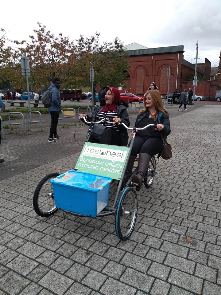 students trying out funny bikes