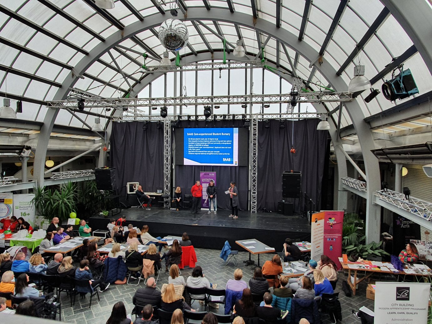 students on stage and audience