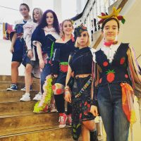 group shot of students modelling creations