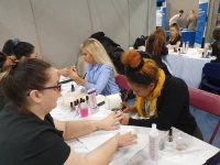 students giving manicures