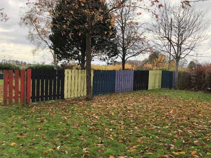 Fence painted different colours