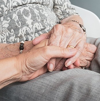 holding an elder persons hand