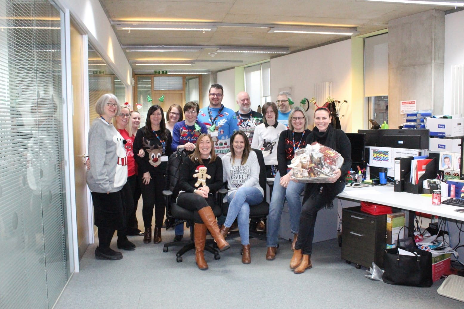 some of our staff in their Christmas jumpers