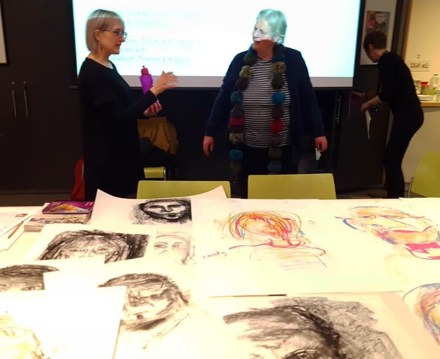 Nicola Carberry with teachers and artwork