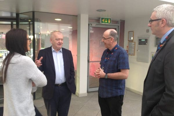 Sir Tom Devine talking to staff and students