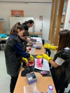 students working with dye