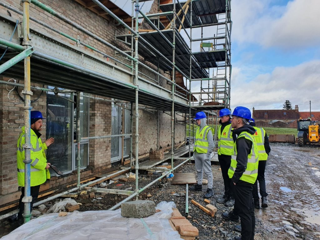 students looking at scaffolding