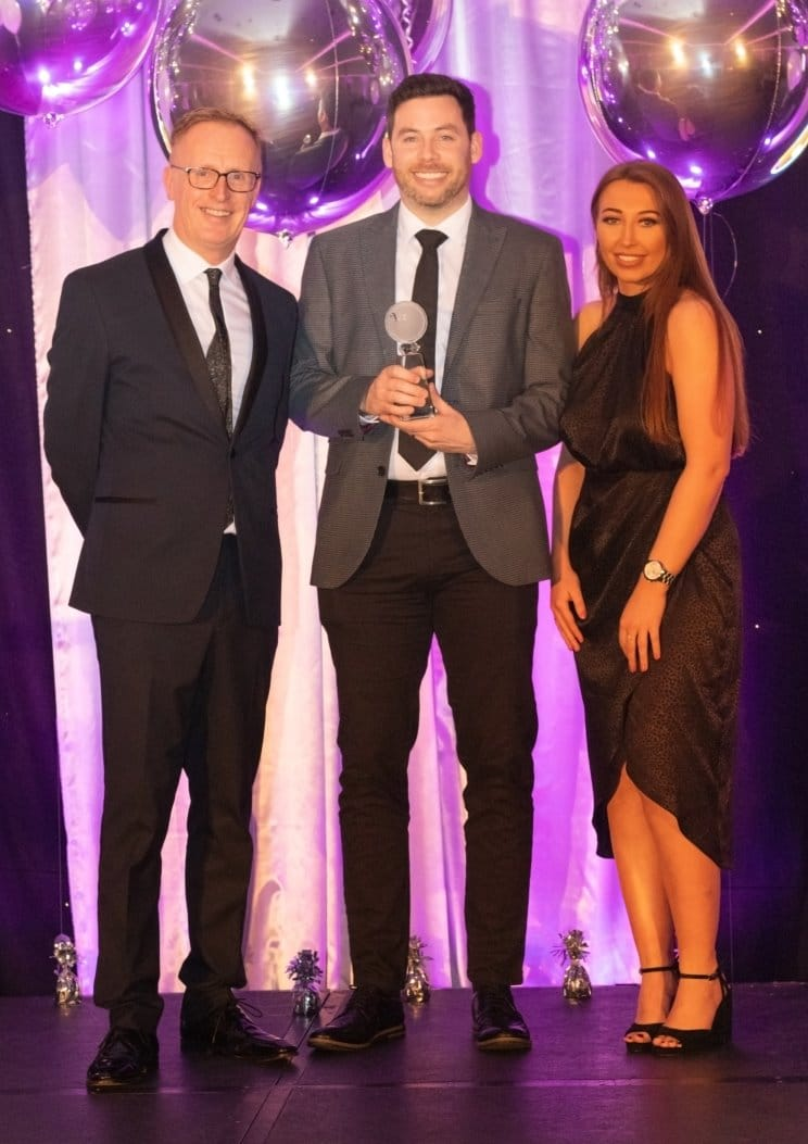 Phil is pictured here accepting the award from Lauren Hall of Active Scotland and media personality, Bryan Burnett