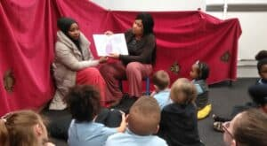 ESOL achievers reading with children