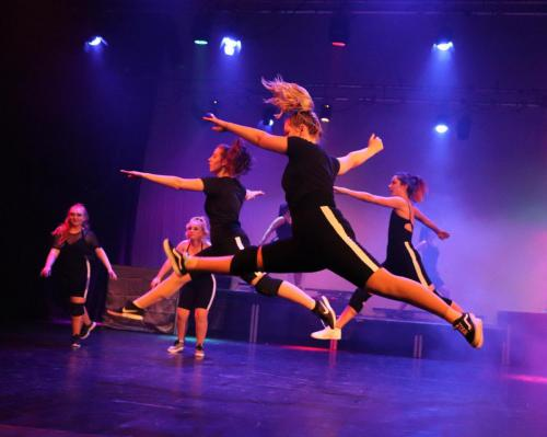 Dancers leaping in air