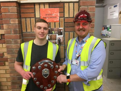 Michael receiving the apprentice shield from Cameron Inglis