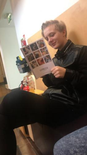 student reading leaflet on espresso
