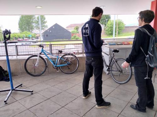 Technician with student looking at bikes
