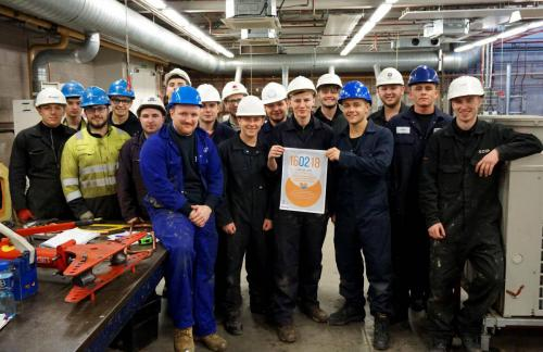 Construction students with care day poster