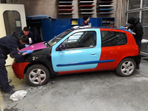 Car bodywork painted in various colours