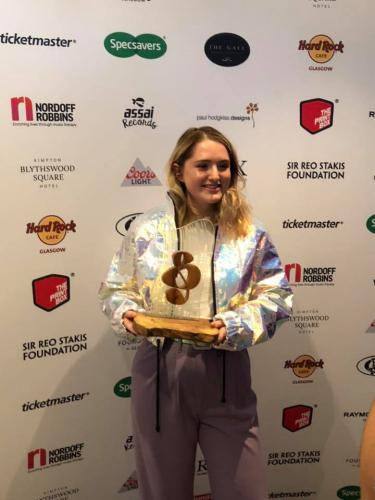 Charlotte Brimner with award