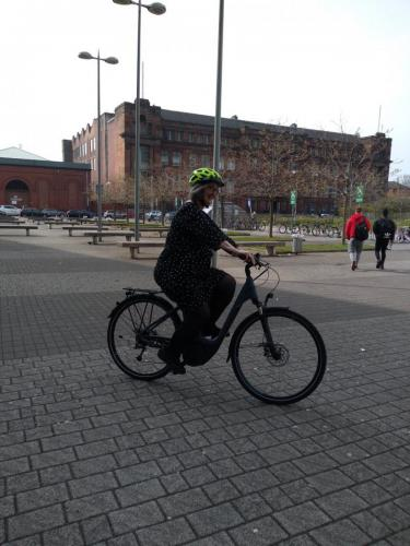 Staff member trying out e-bike
