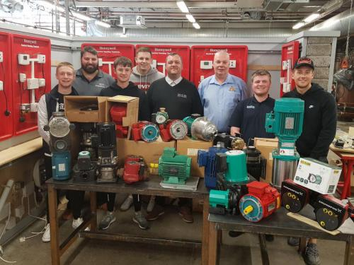 John and David are pictured with current Service and Maintenance apprentices.