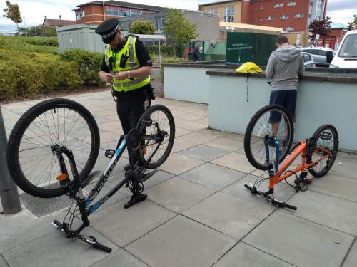 Upside down bikes, police and student