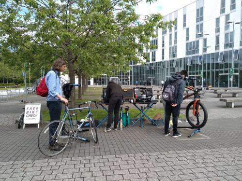 Bicycles, students and a technician
