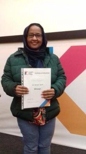 ESOL Student holding certificate