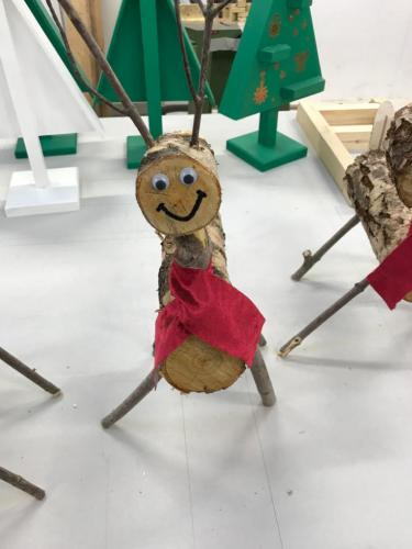reindeer made from logs and sticks