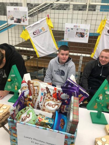 students selling sweets and gifts
