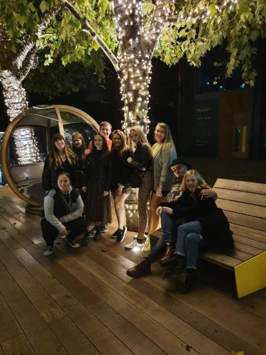 Group shot of fashion students at night
