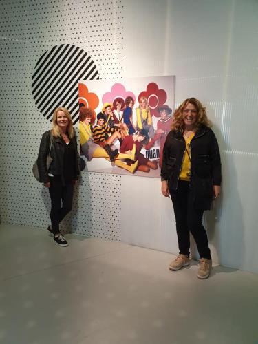 Staff members in front of artwork