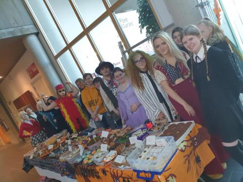group shot of students at cake table