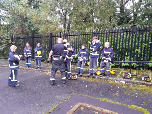Students trying on Fire Service uniforms