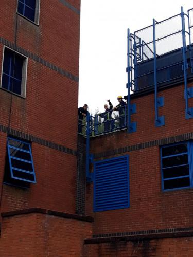 students on roof of fire station