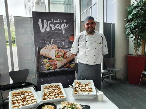 Chef with samples of filled wraps