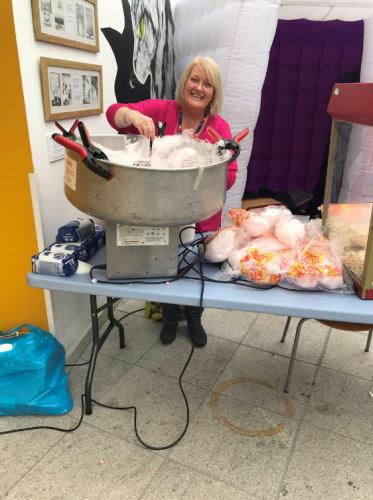 staff member making candy floss
