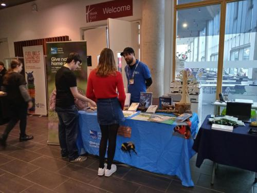 students talking to rspb stall