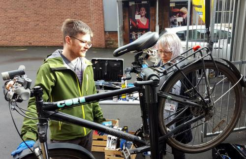 Examining a bike during Go Green Week
