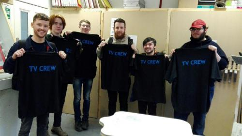 students with crew tshirts